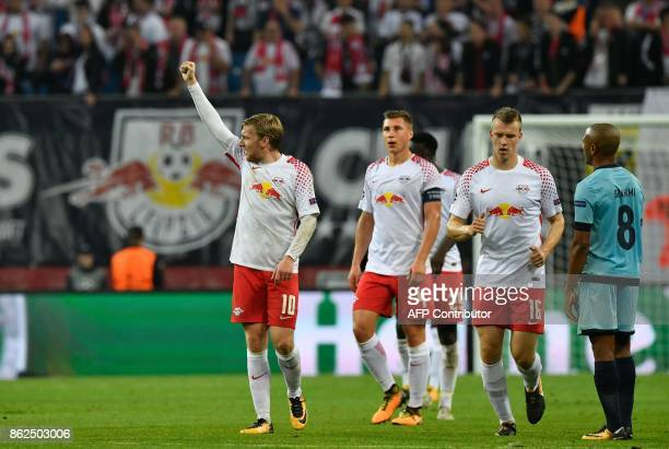 Leipzig´s Swedish forward Emil Forsberg celebrates scoring the 21 goal with his teammates during the UEFA Champions League group G football match RB...