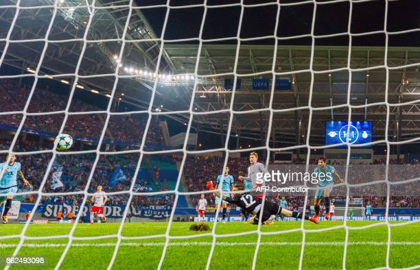 Leipzig´s Swedish forward Emil Forsberg scores the 21 goal during the UEFA Champions League group G football match RB Leipzig v FC Porto in Leipzig...