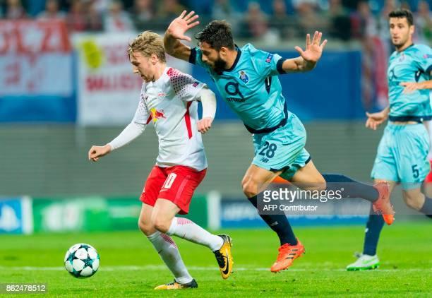 Leipzig´s Swedish forward Emil Forsberg scores the 21 goal next to Porto´s Brazilian defender Felipe during the UEFA Champions League group G...