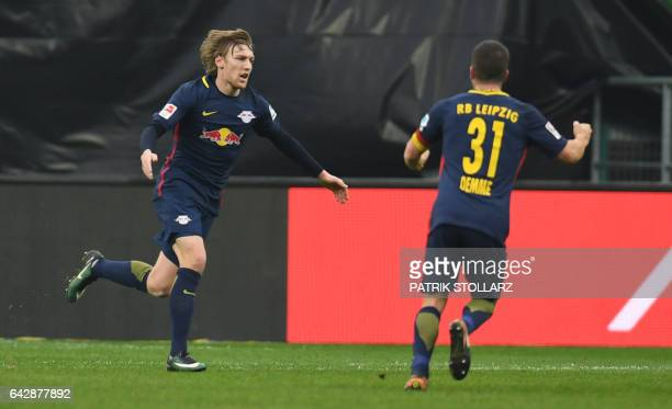 Leipzig´s Swedish midfielder Emil Forsberg celebrates scoring the 01 goal with his teammate midfielder Diego Demme during the German first division...