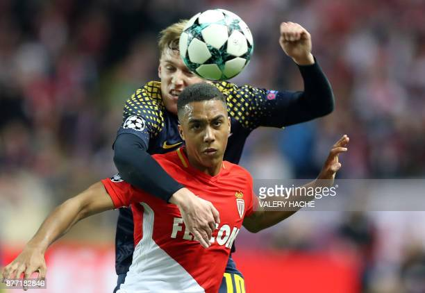 TOPSHOT Leipzig's Swedish midfielder Emil Forsberg vies for the ball with Monaco's Belgian midfielder Youri Tielemans during the UEFA Champions...