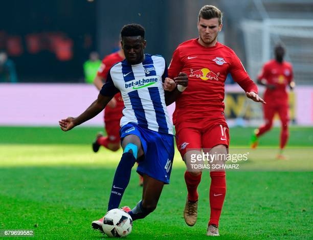 Leipzig's Timo Werner and Hertha Berlin's Jordan Torunarigha vie for the ball during the German First division Bundesliga football match between...