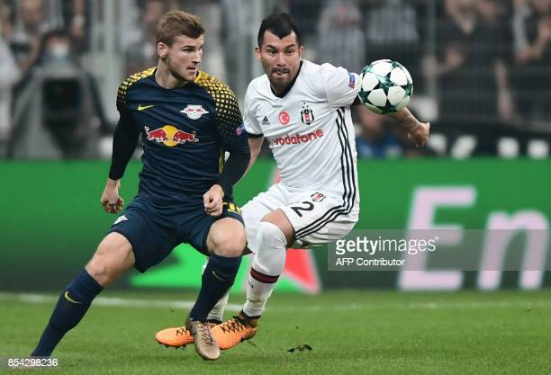 Leipzig's Timo Werner fights for the ball with Besiktas` Gary Medel during the UEFA Champions League group G football match between Besiktas and RB...