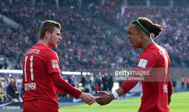 Leipzig's Yussuf Poulsen congratulates team mate Leipzig's Timo Werner scoring during the German First division Bundesliga football match between...
