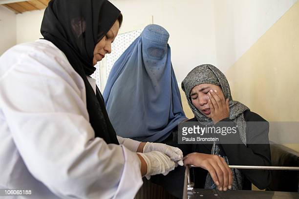 A leishmaniasis patients cries while getting a painful injection of Sodium Stibogluconate at a free specialized clinic for Leishmaniasis supported by...