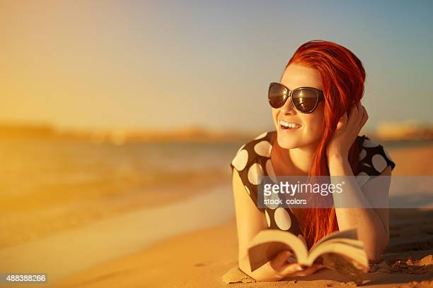 leisure moment on beach, reading a book