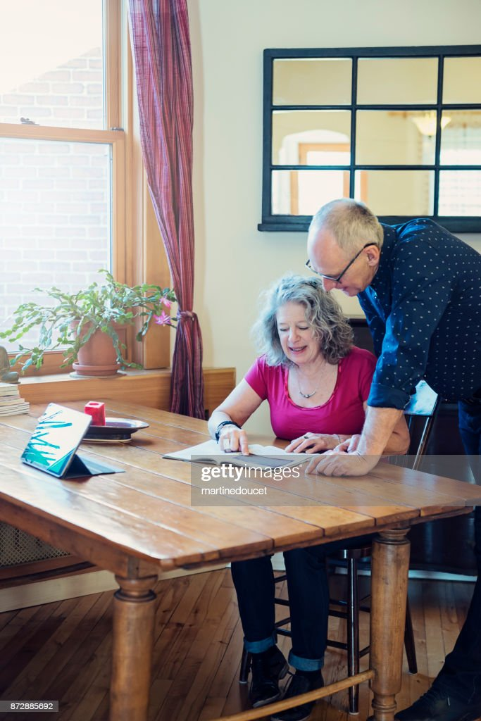 Leisure time for senior couple with digital table and magazine. : Stock Photo