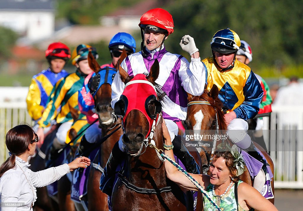 Leith Innes aboard Ocean Park celebrates winning the Lindauer New Zealand Stakes Group One race at Ellerslie Racecourse on March 9, 2013 in Auckland, New Zealand.