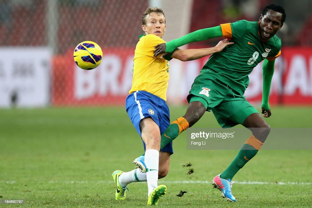 Leiva Lucas of Brazil (Left) competes the ball with Mtonga Ondwani of Zambia (Right) during the international friendly match between Brazil and Zambia at Beijing National Stadium on October 15, 2013 in Beijing, China.
