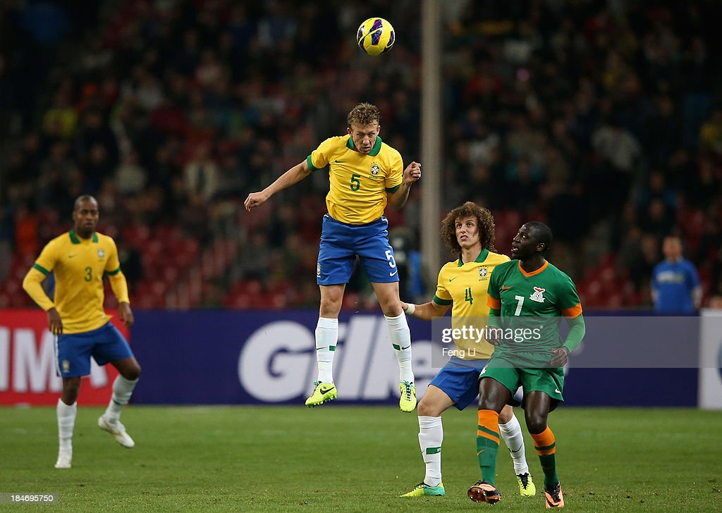 Leiva Lucas of Brazil (Center) heads the ball during the international friendly match between Brazil and Zambia at Beijing National Stadium on October 15, 2013 in Beijing, China.