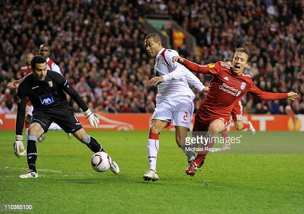 Leiva Lucas of Liverpool is tackled by Alberto Rodriguez of SC Braga during the UEFA Europa League Round of 16 second leg match between Liverpool and...