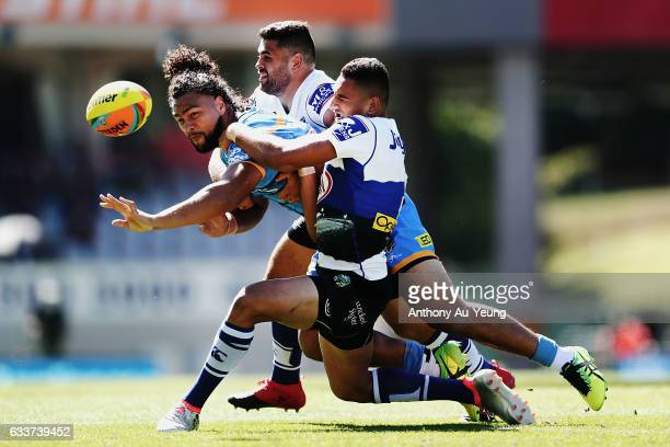 Leivaha Pulu of the Titans offloads the ball in a tackle during the 2017 Auckland Nines match between the Titans and the Bulldogs at Eden Park on...