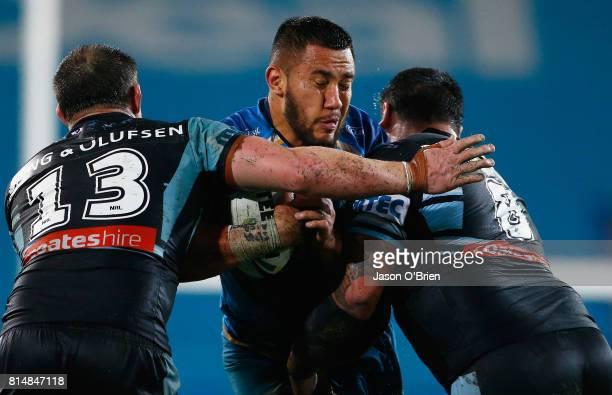 Leivaha Pulu of the titans runs with the ball during the round 19 NRL match between the Gold Coast Titans and the Cronulla Sharks at Cbus Super...