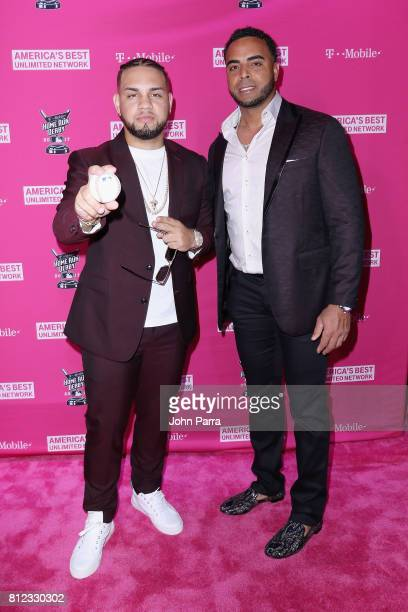 Lejuan James and Nelson Cruz arrive at the TMobile Presents Derby After Dark at Faena Forum on July 10 2017 in Miami Beach Florida