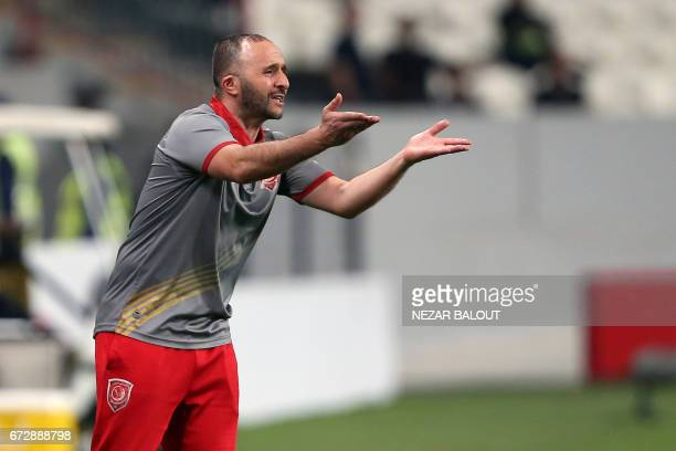 Lekhwiya's coach Djamel Belmadi instructs his players during their AFC Champions League group B football match between Qatar's Lekhwiya and UAE's...