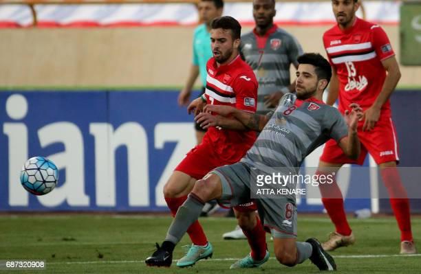 Lekhwiya's Luiz Junior fights for the ball against Persepolis' Soroush Rafei during the Asian Champions League football match between Qatar's...
