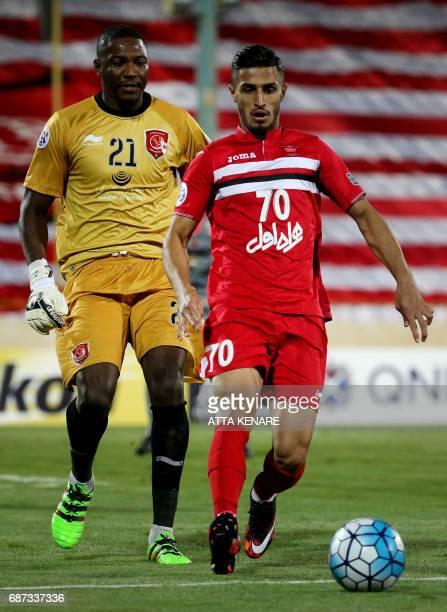 Lekhwiya's Qasem Abdullhamed runs after Persepolis' Ali Alipour during the Asian Champions League football match between Qatar's Lekhwiya SC and...