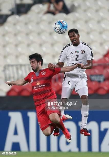 Lekhwiya's Qatari defender Khalid Muftah vies for the header with Jazira's Emirati defender Mohamed Fawzi during their AFC Champions League group B...