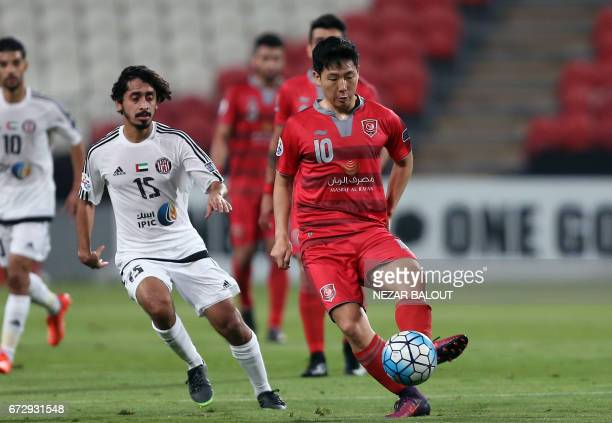 Lekhwiya's South Korean midfielder Nam Taehee dribbles past Jazira's Emirati midfielder Khalfan Mubarak during their AFC Champions League group B...