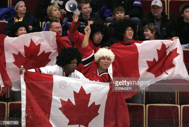 Supporters of the Canadian team wave their national flag during the first period action of the match Canada vs Slovakia at the World U20 hockey...