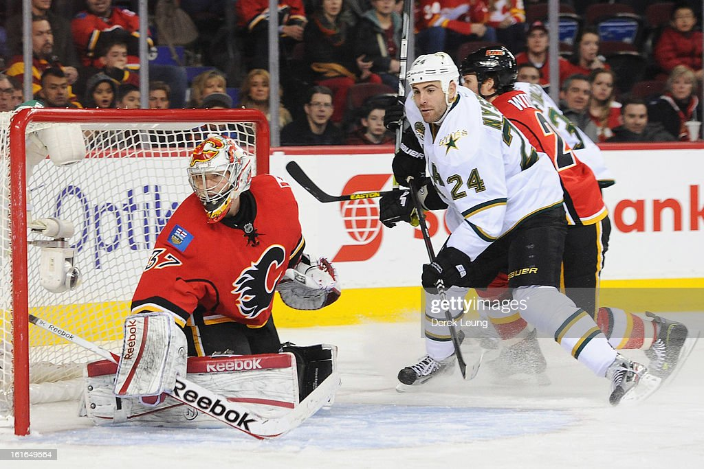 Leland Irving #37 of the Calgary Flames and <a gi-track='captionPersonalityLinkClicked' href=/galleries/search?phrase=Eric+Nystrom&family=editorial&specificpeople=2209813 ng-click='$event.stopPropagation()'>Eric Nystrom</a> #24 of the Dallas Stars watch the puck during an NHL game at Scotiabank Saddledome on February 13, 2013 in Calgary, Canada. Flames won 7-4.