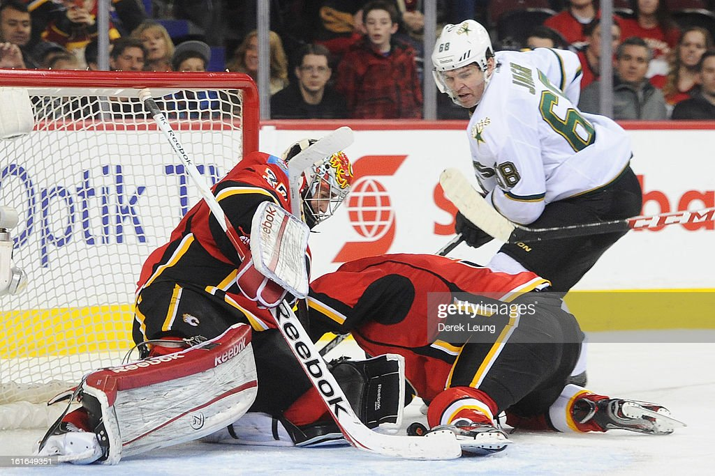 Leland Irving #37 of the Calgary Flames eyes the loose puck as Jaromir Jagr #68 of the Dallas Stars looks for an opportunity during an NHL game at Scotiabank Saddledome on February 13, 2013 in Calgary, Canada. Flames won 7-4.