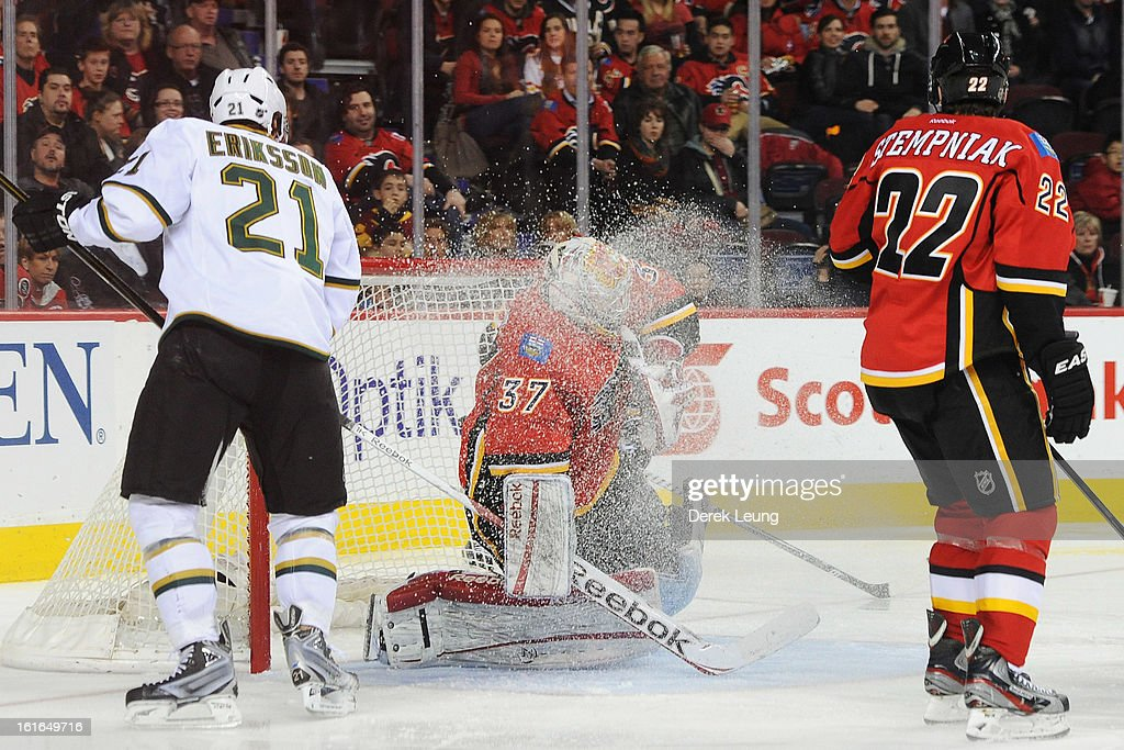 Leland Irving #37 of the Calgary Flames gets a snow shower during the game against the Dallas Stars during an NHL game at Scotiabank Saddledome on February 13, 2013 in Calgary, Canada. Flames won 7-4.