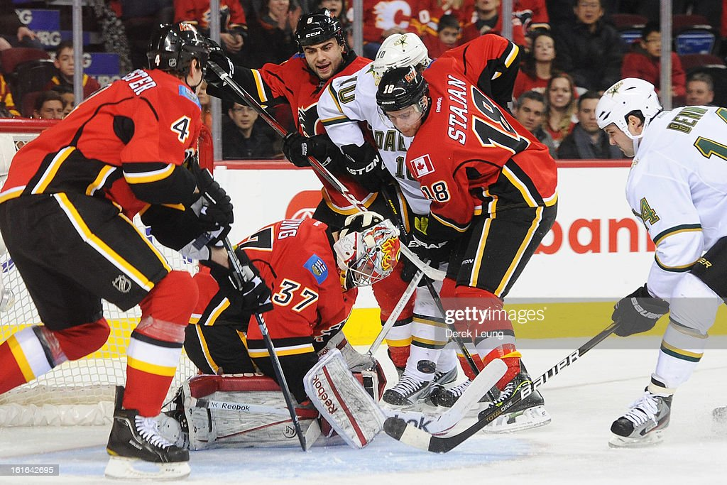 Leland Irving #37 of the Calgary Flames stops the shot of <a gi-track='captionPersonalityLinkClicked' href=/galleries/search?phrase=Jamie+Benn&family=editorial&specificpeople=4595070 ng-click='$event.stopPropagation()'>Jamie Benn</a> #14 of the Dallas Stars during an NHL game at Scotiabank Saddledome on February 13, 2013 in Calgary, Canada.