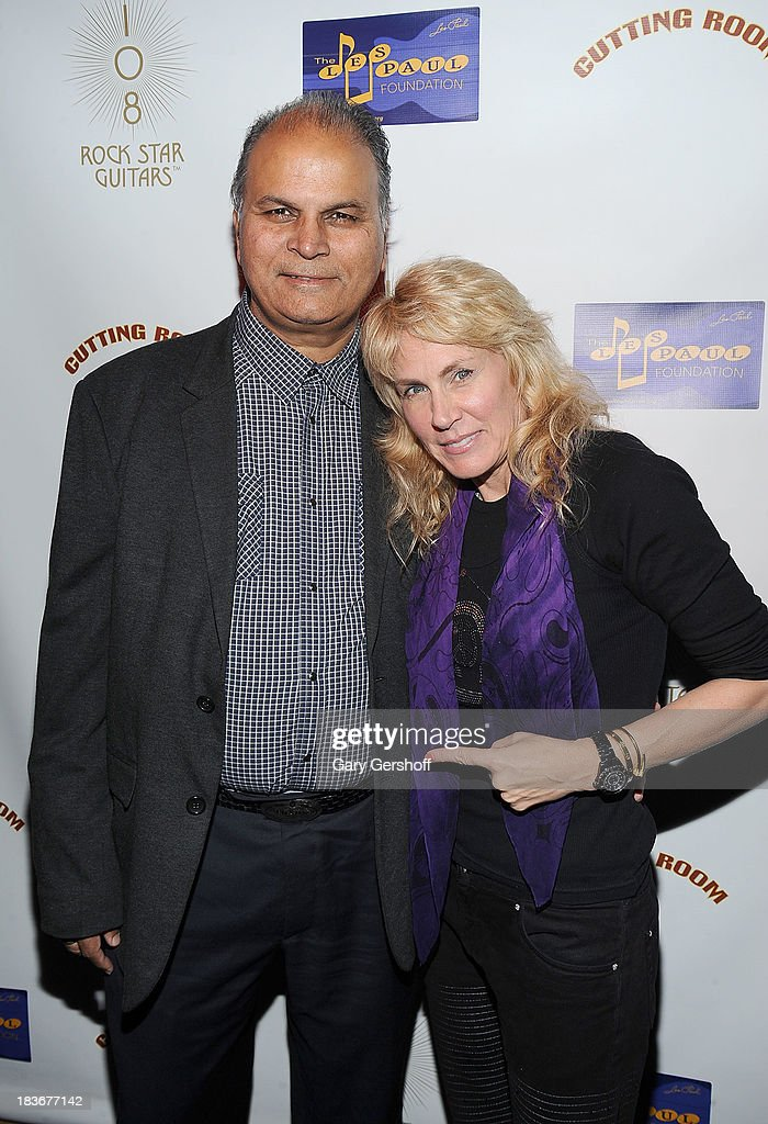 Leli Kumer (L) and author and photographer Lisa Johnson attend the book launch and performance for '108 Rock Star Guitars' benefitting The Les Paul Foundation at The Cutting Room on October 8, 2013 in New York City.