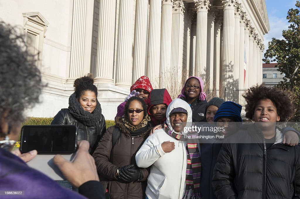 A'Lelia Bundles photographs from left Caprice Smith, Candice Coles, Kameron Coles, Brenden Coles, Angela Jackson, Mya Bennett, Liam Smith, Anthony Brock and Noah Smith Sunday, December 30, 2012 in Washington, DC. The families, from Baltimore waited in a line that stretched around the National Archives building to view the Emancipation Proclamation that was making a rare appearance on the 150th anniversary.