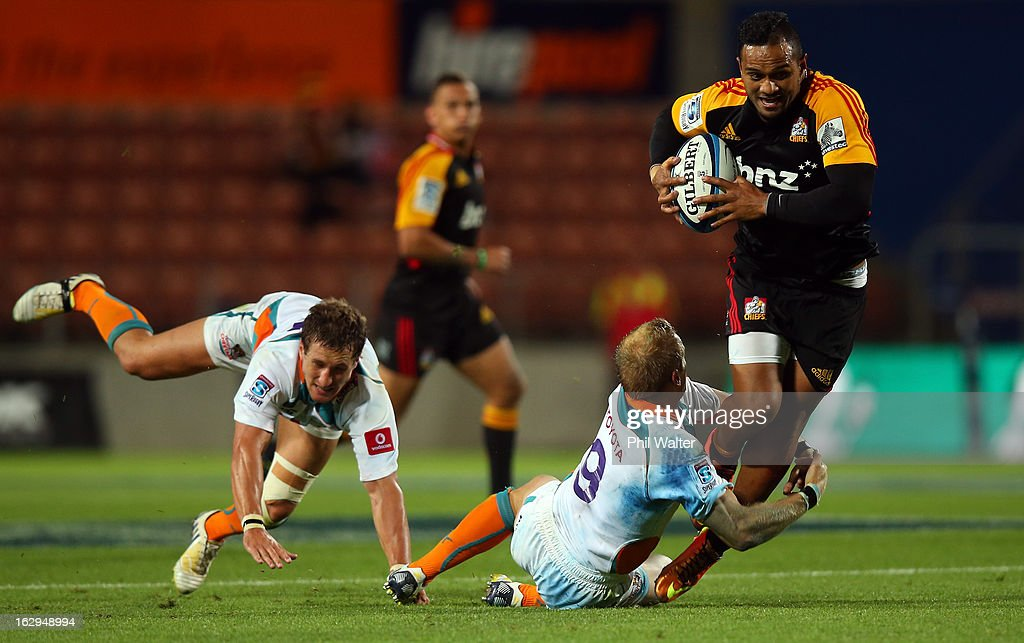Lelia Masaga of the Chiefs is tackled by Sarel Pretorius of the Cheetahs during the round three Super Rugby match between the Chiefs and the Cheetahs at Waikato Stadium on March 2, 2013 in Hamilton, New Zealand.