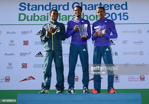 Lelisa Desia Benti of Ethiopia Lemi Berhanu Hayle of Ethiopia and Deirbe Robi Meka of Ethiopia pose on the podium after the Standard Chartered Dubai...