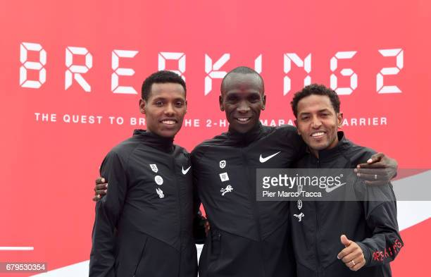 Lelisa Desisa Eliud Kipchoge and Zersenay Tadese celebrate the Nike Breaking2 SubTwo Marathon Attempt at Autodromo di Monza on May 6 2017 in Monza...