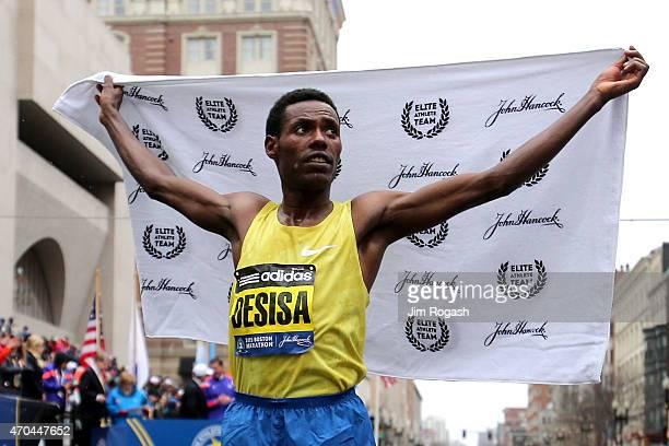 Lelisa Desisa of Ethiopa celebrates after winning the 119th Boston Marathon on April 20 2015 in Boston Massachusetts