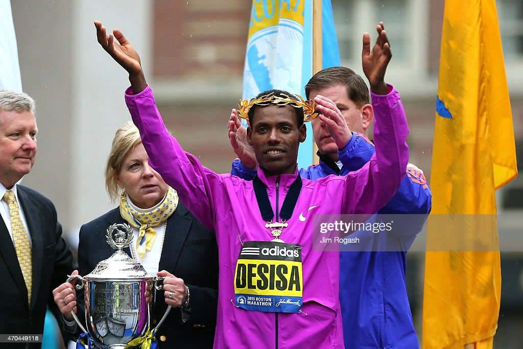 Lelisa Desisa of Ethiopa is presented with the laurel wreath by Boston Mayor Marty Walsh after winning the 119th Boston Marathon on April 20, 2015 in Boston, Massachusetts.