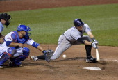 LeMahieu of the Colorado Rockies fails to connect on a suicide squeeze bunt during the tenth inning against the Chicago Cubs on July 29 2014 at...