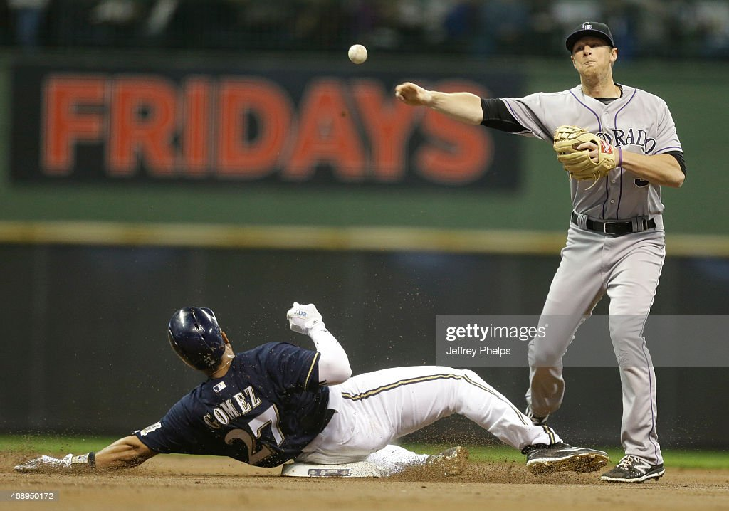 DJ Lemahieu #9 of the Colorado Rockies forces out <a gi-track='captionPersonalityLinkClicked' href=/galleries/search?phrase=Carlos+Gomez+-+Baseball+Player&family=editorial&specificpeople=4530738 ng-click='$event.stopPropagation()'>Carlos Gomez</a> #27 of the Milwaukee Brewers at second base and throws on to first for a double play in the first inning at Miller Park on April 8, 2015 in Milwaukee, Wisconsin.