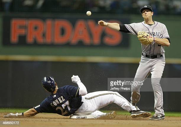 Lemahieu of the Colorado Rockies forces out Carlos Gomez of the Milwaukee Brewers at second base and throws on to first for a double play in the...