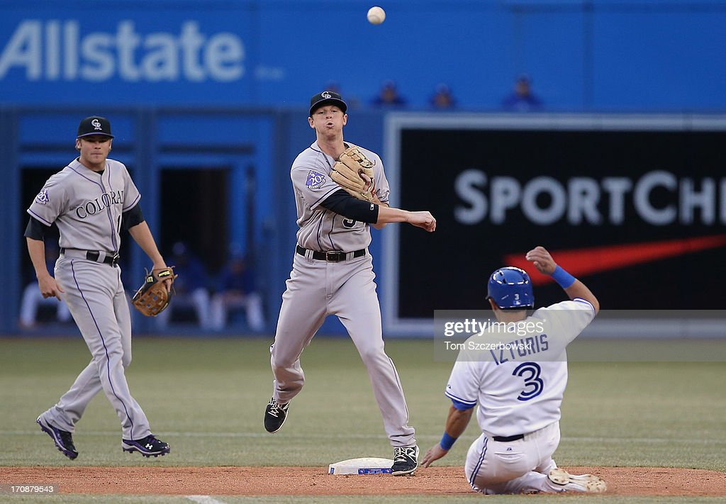 D.J. LeMahieu #9 of the Colorado Rockies gets the force out at second base but cannot turn the double play as <a gi-track='captionPersonalityLinkClicked' href=/galleries/search?phrase=Maicer+Izturis&family=editorial&specificpeople=239100 ng-click='$event.stopPropagation()'>Maicer Izturis</a> #3 of the Toronto Blue Jays slides in the fourth inning during MLB game action on June 19, 2013 at Rogers Centre in Toronto, Ontario, Canada.