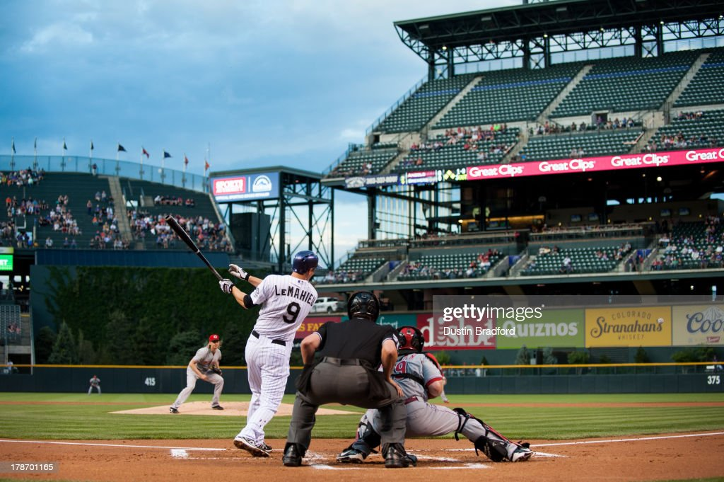 <a gi-track='captionPersonalityLinkClicked' href=/galleries/search?phrase=DJ+LeMahieu&family=editorial&specificpeople=5940806 ng-click='$event.stopPropagation()'>DJ LeMahieu</a> #9 of the Colorado Rockies hits a first-inning RBI double off of <a gi-track='captionPersonalityLinkClicked' href=/galleries/search?phrase=Bronson+Arroyo&family=editorial&specificpeople=204136 ng-click='$event.stopPropagation()'>Bronson Arroyo</a> #61 of the Cincinnati Reds during a game at Coors Field on August 30, 2013 in Denver, Colorado.