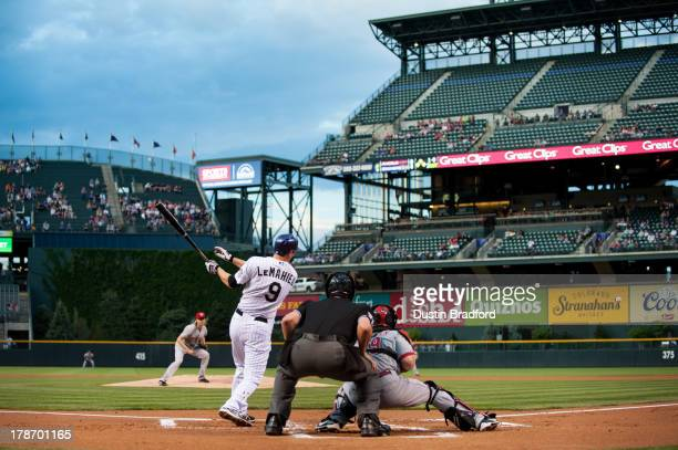 LeMahieu of the Colorado Rockies hits a firstinning RBI double off of Bronson Arroyo of the Cincinnati Reds during a game at Coors Field on August 30...