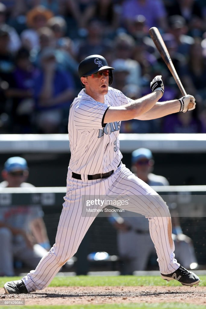 D.J. LeMahieu #9 of the Colorado Rockies hits a RBI single in the ninth inning against the San Francisco Giants at Coors Field on June 18, 2017 in Denver, Colorado.