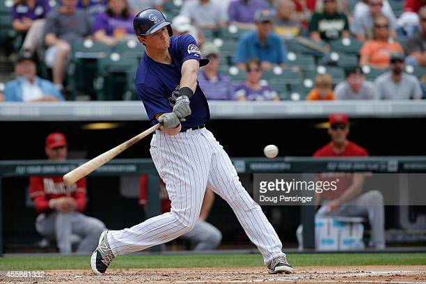 LeMahieu of the Colorado Rockies hits an RBI single off of starting pitcher Wade Miley of the Arizona Diamondbacks to score Drew Stubbs and take a 10...