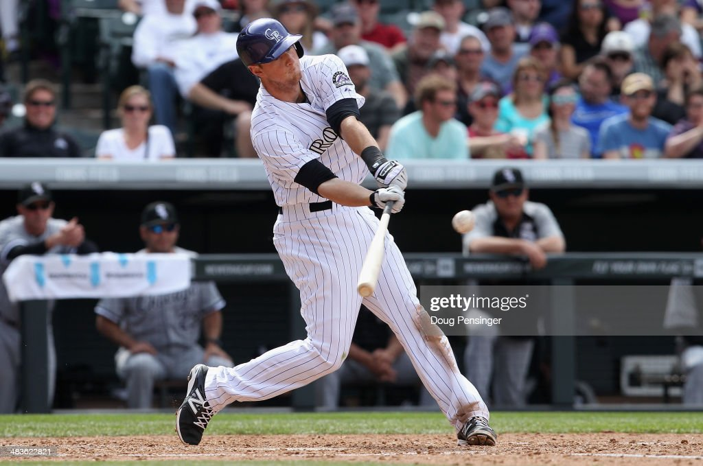 <a gi-track='captionPersonalityLinkClicked' href=/galleries/search?phrase=DJ+LeMahieu&family=editorial&specificpeople=5940806 ng-click='$event.stopPropagation()'>DJ LeMahieu</a> #9 of the Colorado Rockies hits an RBI single to rightfield against the Chicago White Sox to tie the score 4-4 in the sixth inning during Interleague play at Coors Field on April 9, 2014 in Denver, Colorado. The Rockies defeated the White Sox 10-4.