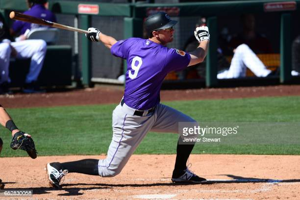 LeMahieu of the Colorado Rockies hits the ball against the against the Arizona Diamondbacks during the spring training game at Salt River Fields at...