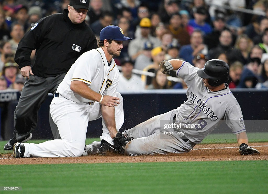 LeMahieu #9 of the Colorado Rockies is tagged out by <a gi-track='captionPersonalityLinkClicked' href=/galleries/search?phrase=Brett+Wallace&family=editorial&specificpeople=2364861 ng-click='$event.stopPropagation()'>Brett Wallace</a> #39 of the San Diego Padres as he tries to steal third base during the fifth inning of a baseball game at PETCO Park on May 2, 2016 in San Diego, California.