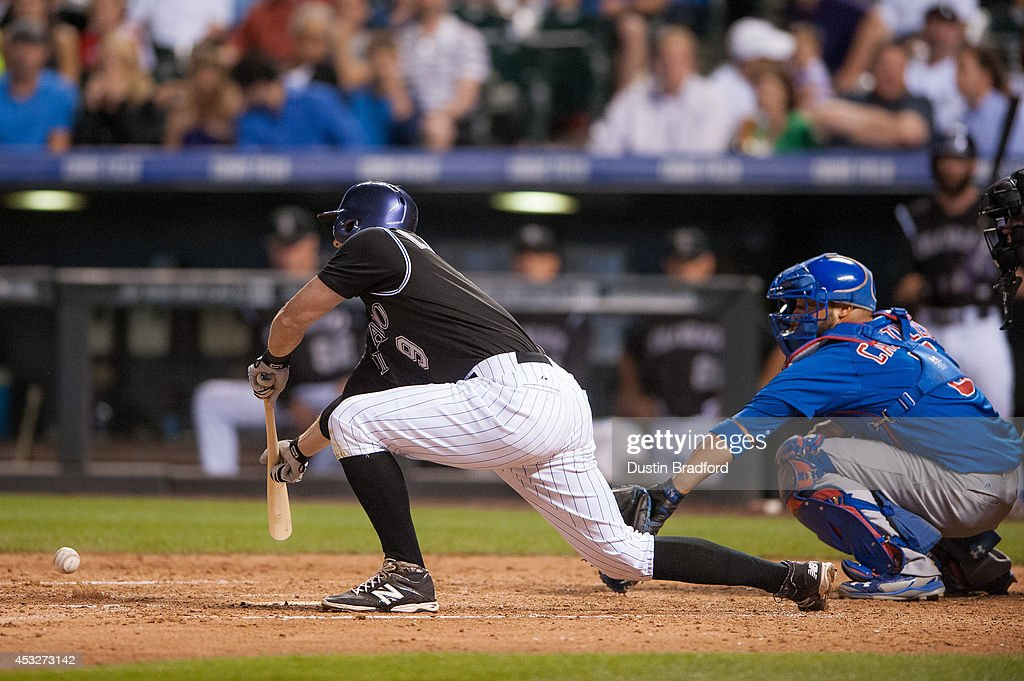 <a gi-track='captionPersonalityLinkClicked' href=/galleries/search?phrase=DJ+LeMahieu&family=editorial&specificpeople=5940806 ng-click='$event.stopPropagation()'>DJ LeMahieu</a> #9 of the Colorado Rockies lays down a suicide squeeze bunt single for an RBI in the sixth inning of a game against the Chicago Cubs at Coors Field on August 6, 2014 in Denver, Colorado.
