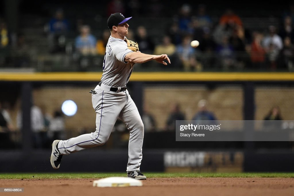 DJ LeMahieu #9 of the Colorado Rockies makes a throw to first base during the second inning of a game against the Milwaukee Brewers at Miller Park on April 5, 2017 in Milwaukee, Wisconsin.