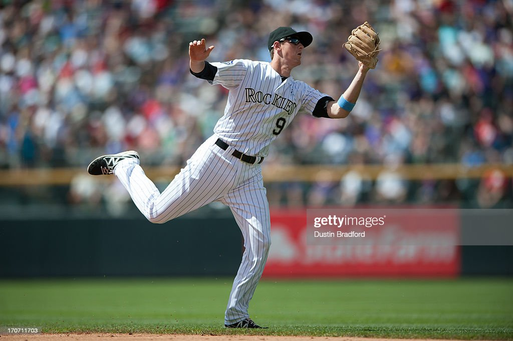 <a gi-track='captionPersonalityLinkClicked' href=/galleries/search?phrase=DJ+LeMahieu&family=editorial&specificpeople=5940806 ng-click='$event.stopPropagation()'>DJ LeMahieu</a> #9 of the Colorado Rockies makes an athletic catch at first base to take a hit away from Freddy Galvis #13 of the Philadelphia Phillies (not pictured) during a game at Coors Field on June 16, 2013 in Denver, Colorado. The Rockies beat the Phillies 5-2.