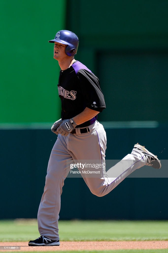 <a gi-track='captionPersonalityLinkClicked' href=/galleries/search?phrase=DJ+LeMahieu&family=editorial&specificpeople=5940806 ng-click='$event.stopPropagation()'>DJ LeMahieu</a> #9 of the Colorado Rockies runs the bases after hitting a solo home run in the first inning during a game against the Washington Nationals at Nationals Park on June 22, 2013 in Washington, DC.